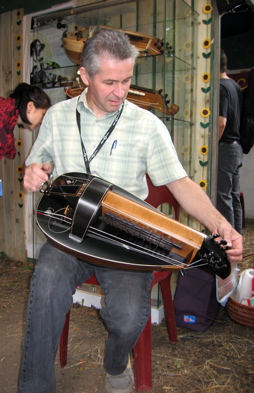 A vielle à roue, held by its maker, one of the best luthiers in the world, Bernard Kerboeuf.