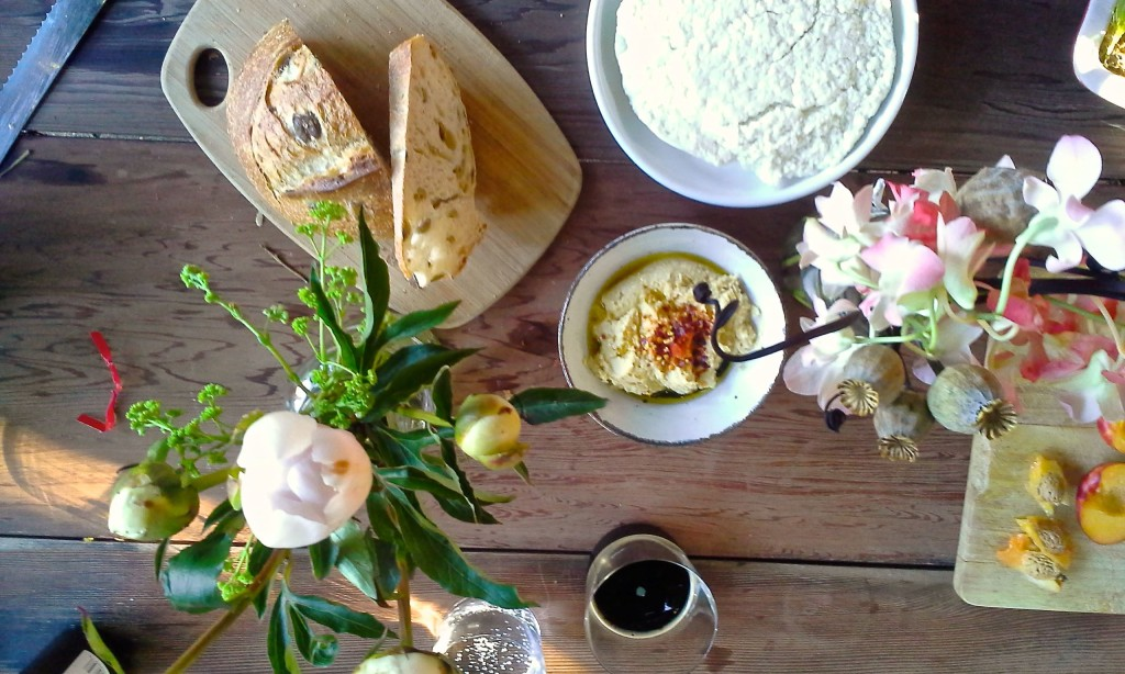 Homemade hummus, homemade queso blanco, Acme olive bread, peonies.