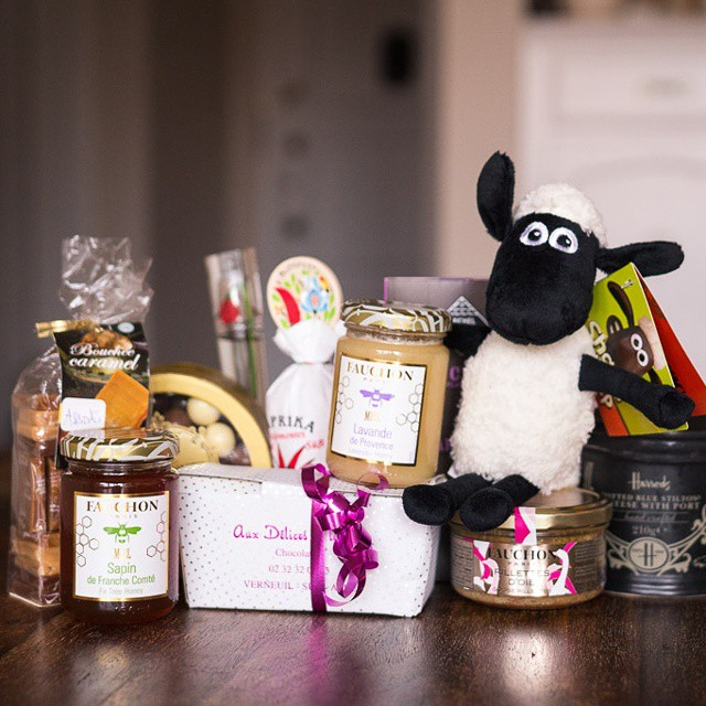 M. Cheesemonger just returned from a business trip in #London, which means one very important thing.... #presents! #shaunthesheep #michelcluizel #chocate #fauchon #honey #caramels #rillettes @kenzo #flower @harrods #potted #stilton #marronsglaces #allthethings #thankyou