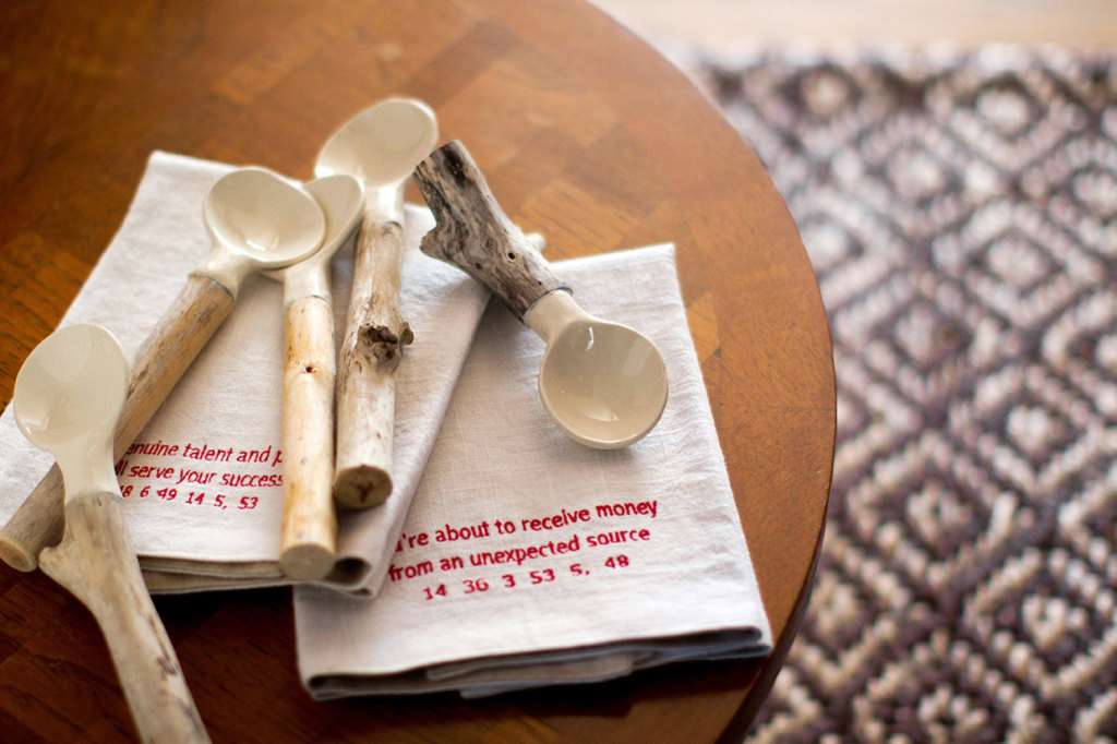 Some of Linda's Ceramic and Driftwood Spoons and Shannon's Good Fortune Napkins. Photo (C) Madelene Farin Photography 2014.