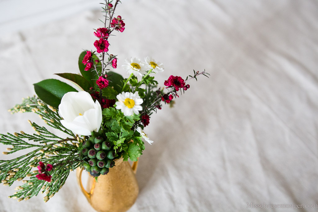 What An Adorable Little Holiday Posey. With Tulip, Cedar, Red-Tipped Photinia, Feverfew.