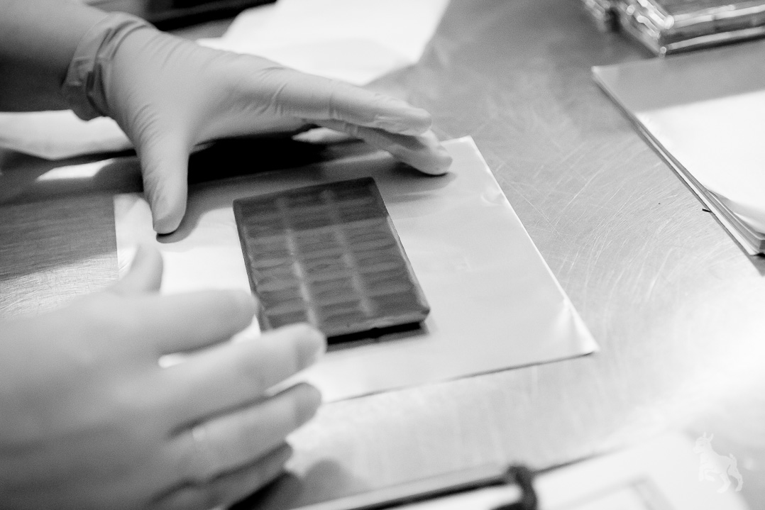Wrapping the chocolate by hand.