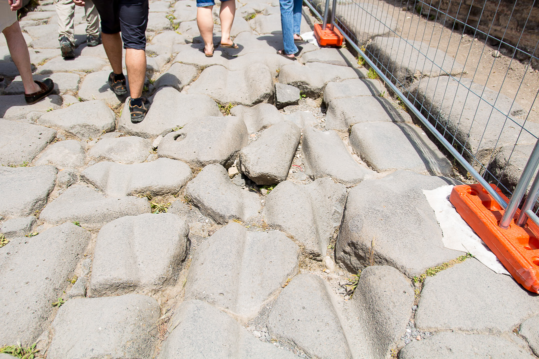 These wagon wheel grooves in the roads intrigued me to no end!  In Pompeii.