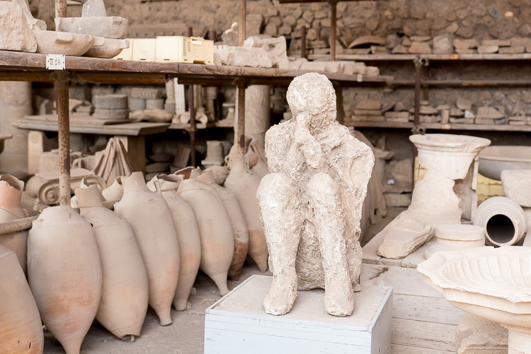 A plaster cast of a man. At Pompeii.