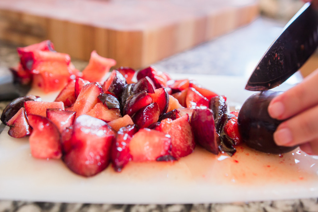 Cutting the plums for the plum confit. Panna cotta recipe on misscheesemonger.com.
