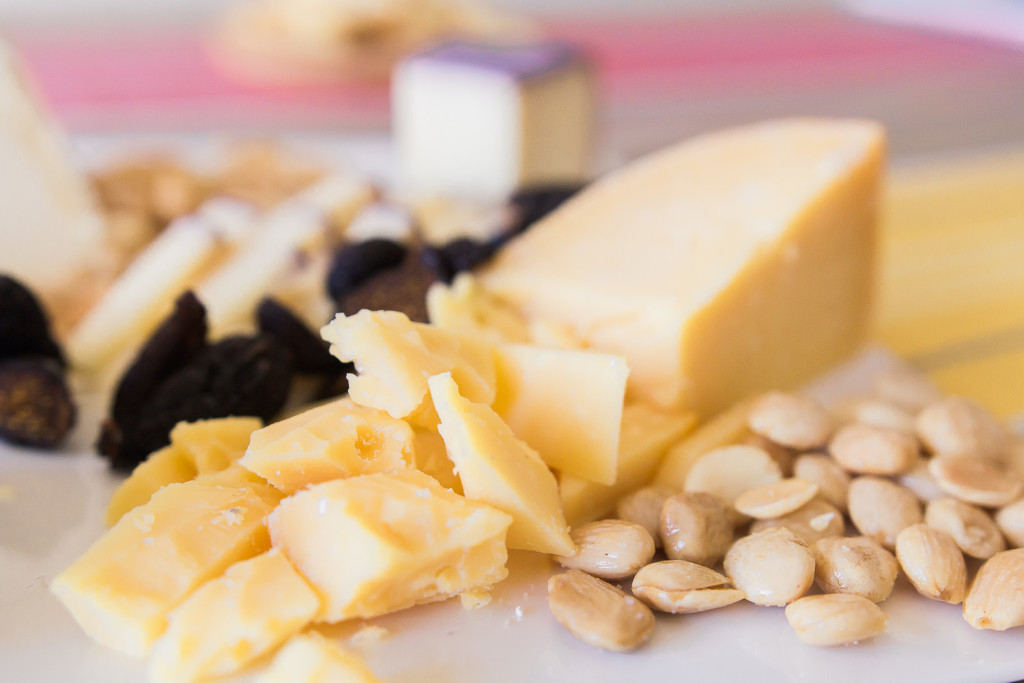 Cutting up harder cheeses lets people grab them with ease. An all Trader Joe's cheese plate on misscheesemonger.com.