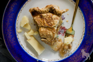 Celebrate Pi Day with apple pie and cheddar cheese. By Vero Kherian for misscheesemonger.com.