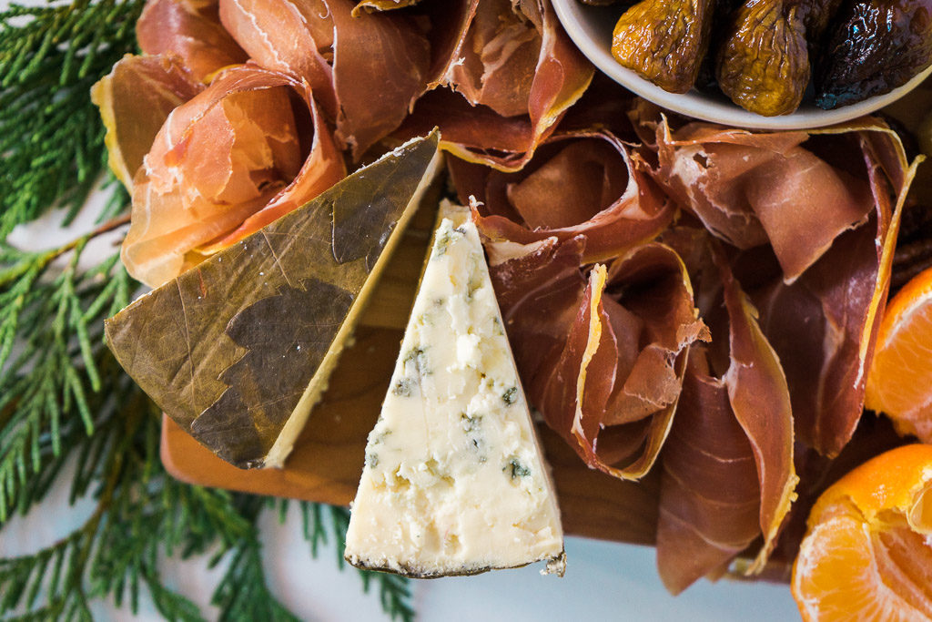 Rogue River Blue comes cloaked in pear brandy-infused grape leaves, and is available only around the holidays. One taste of it, and you will wish you got a bigger wedge. An unforgettable holiday cheese board with Cheese Plus. By Vero Kherian for misscheesemonger.com.