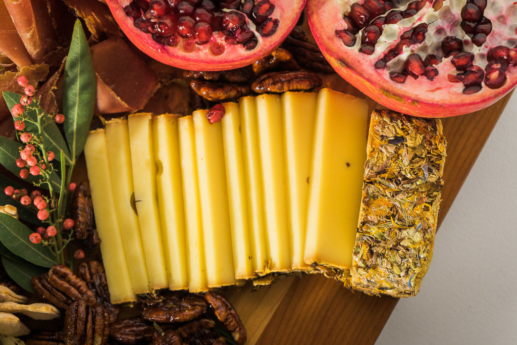 Alp Blossom adds some summertime flavor and festive flowers to your cheese board. An unforgettable holiday cheese board with Cheese Plus. By Vero Kherian for misscheesemonger.com.