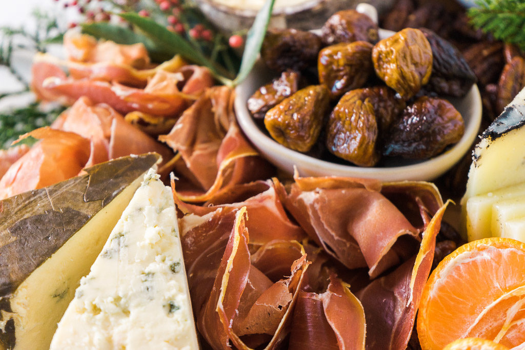 A river of Jambon de Bayonne flowing between cheeses. Yum . . . An unforgettable holiday cheese board with Cheese Plus. By Vero Kherian for misscheesemonger.com.