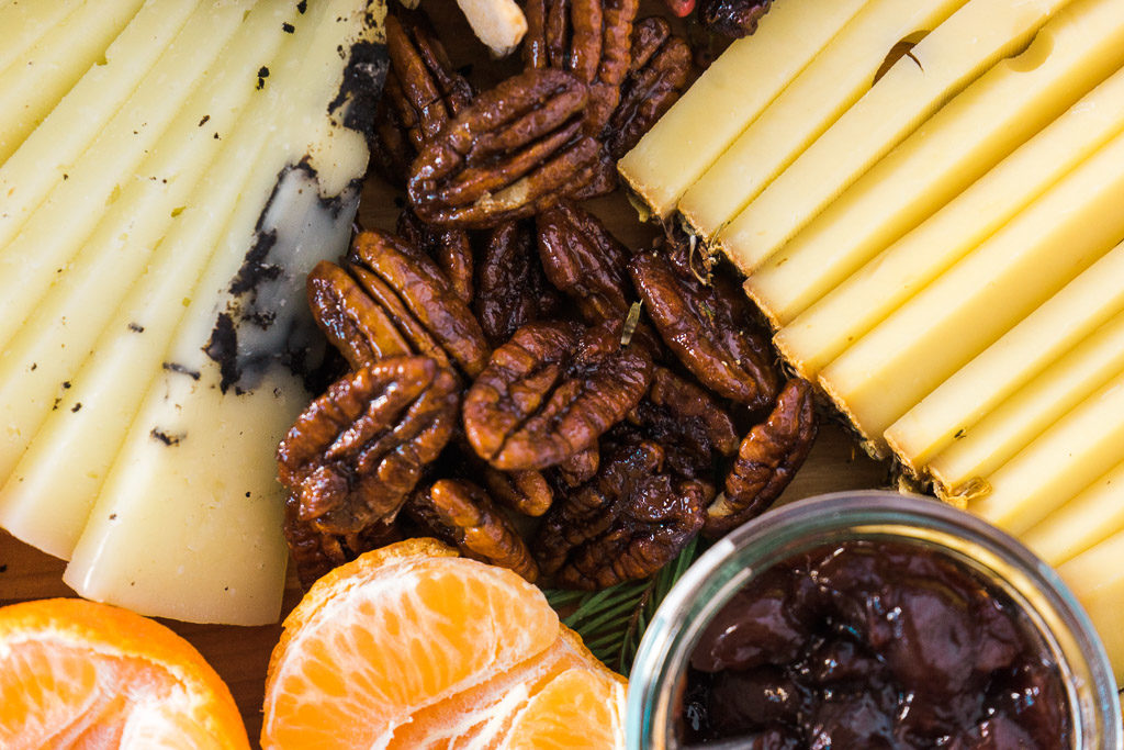 Caramelized pecans--as if you needed another excuse to eat more pecans! An unforgettable holiday cheese board with Cheese Plus. By Vero Kherian for misscheesemonger.com.